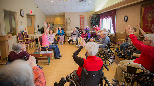 Resident performing Chair Chi with Westview's Recreation Director, Louise Taylor