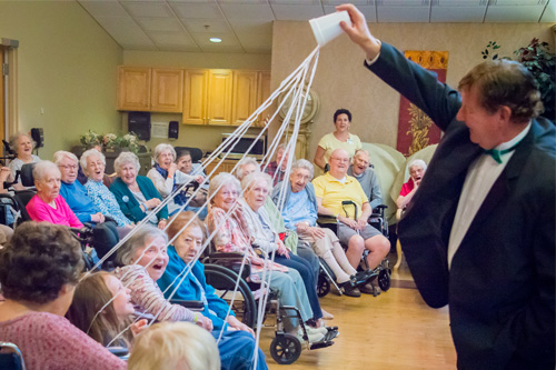 Magician Brian LaPalme delights his audience at Westview Health Care Center