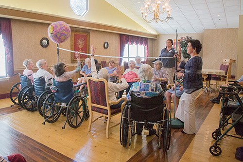 Residents playing indoor volleyball