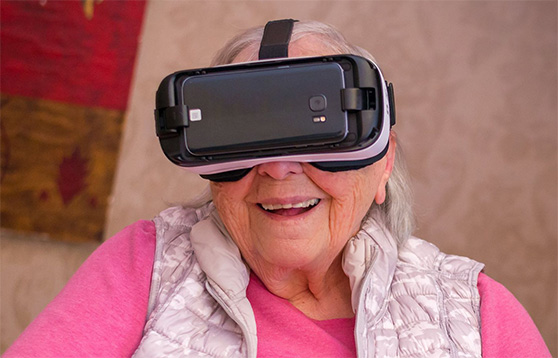 Photo of Westview resdient wearing a Virtual Reality headset